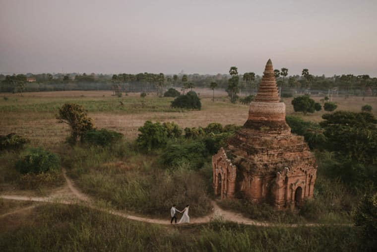 bride and groom walking in bagan