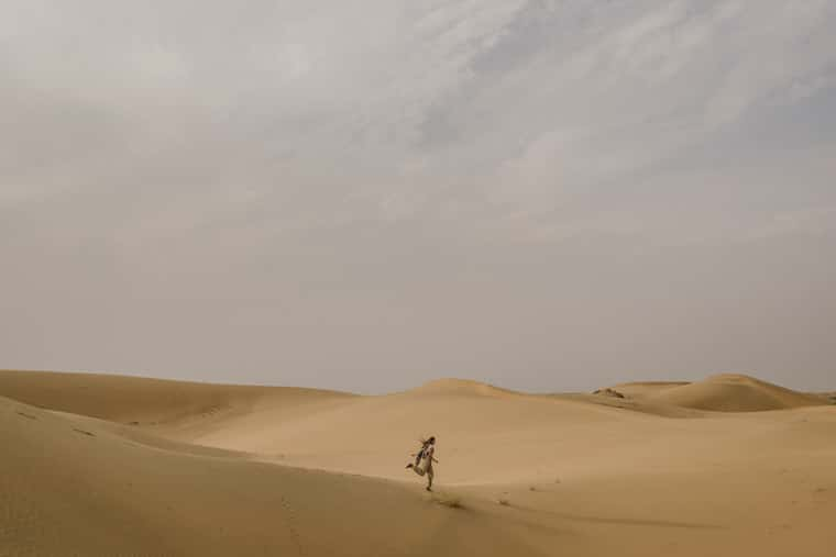 girl running in the desert in jaisalmer