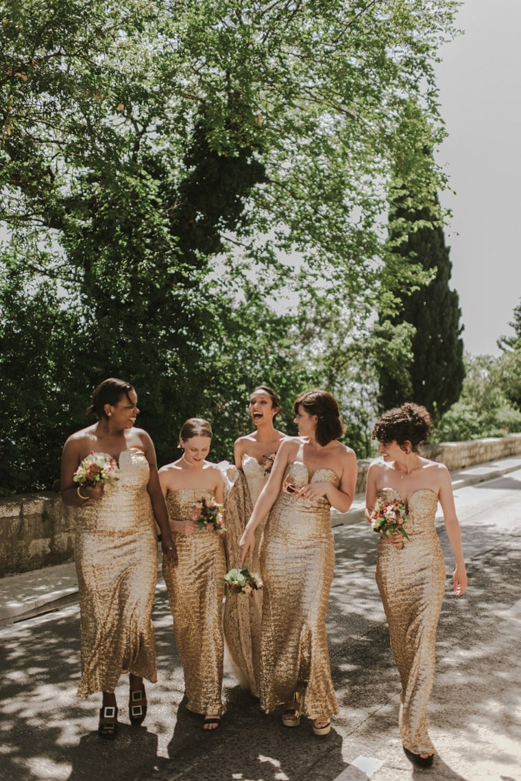 happy bridal party walking down the street in dubrovnik