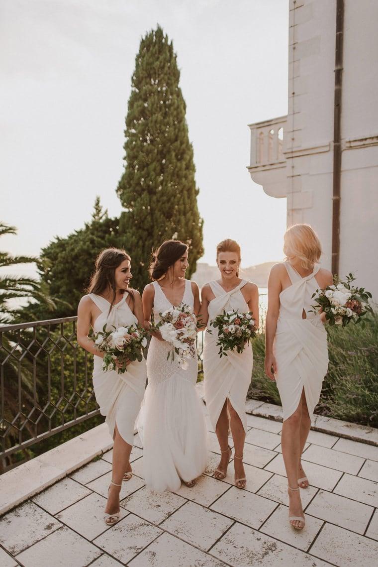 happy bridal party in dubrovnik villa argentina