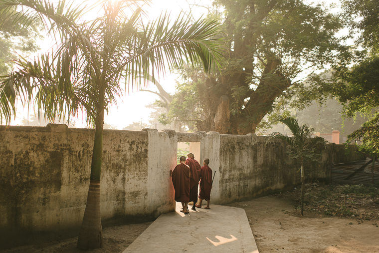 Old Monk heading phone for a walk from his monastery in mandalay