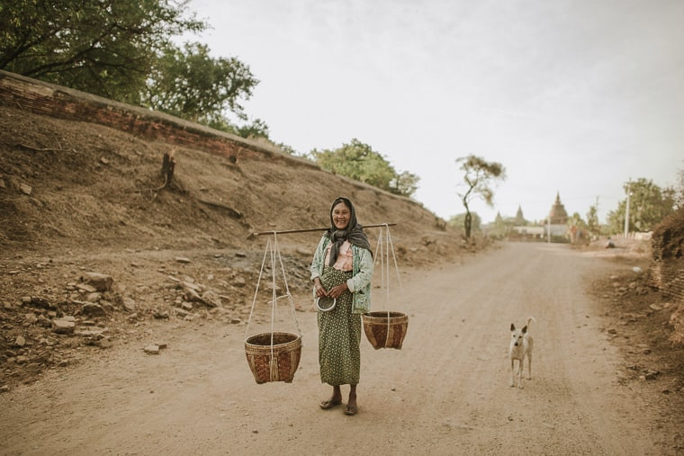 Old woman carrying things